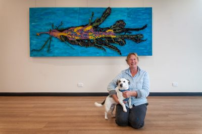 Artist Deb Cobern with Gus and her artwork 'Leafy Sea Dragon'